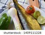 Stock photo mediterranean food smoked herring fish served with green onion lemon tomatoes green pepper olive 1409111228