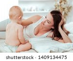 happy mom talking to the baby... | Shutterstock . vector #1409134475