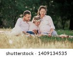 happy family sitting on the... | Shutterstock . vector #1409134535