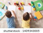 Little children drawing indoors ...