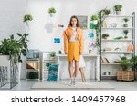 beautiful young woman standing... | Shutterstock . vector #1409457968