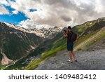 tourist with backpack stands on ... | Shutterstock . vector #1409482412