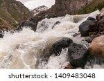 rough mountain river baksan.... | Shutterstock . vector #1409483048