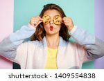 Small photo of My favorite cookies. Pretty girl covering eyes with cookies. Bakery style chocolate chip cookie recipe. Cute girl having fun with cookies. Following a cooking recipe. Bakery shop.