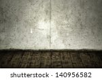 Concrete crack wall and brown hardwood floor - stock photo