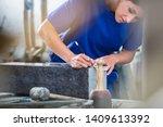 Diligent Craftswoman Applying...