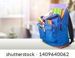 open blue school backpack on a...   Shutterstock . vector #1409640062