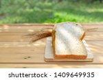 grain bread on wooden table in... | Shutterstock . vector #1409649935
