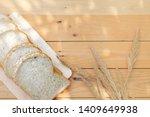 grain bread on wooden table in... | Shutterstock . vector #1409649938