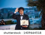 """Small photo of CANNES, FRANCE - MAY 25, 2019: South Korean director Bong Joon-Ho the winner Palme d'Or for the film """"Parasite (Gisaengchung)"""" during the closing ceremony of the 72 Cannes Film Ferstival"""
