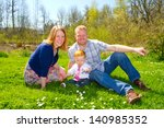 a mom and dad with their one... | Shutterstock . vector #140985352