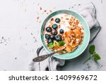 healthy breakfast or dessert.... | Shutterstock . vector #1409969672