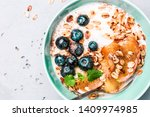 healthy breakfast or dessert... | Shutterstock . vector #1409974985