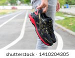 Small photo of Bangkok, Thailand - May 4, 2019 :Woman Hand holding ASICS Running Shoes GT-2000 7, ASICS is a Japanese multinational corporation athletic equipment company which produces footwear and sports equipment