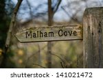 A Wooden Direction Sign To...