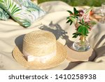 Straw Hats Lay On A White...