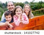 happy family enjoying their... | Shutterstock . vector #141027742