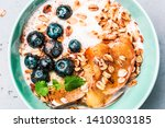 healthy breakfast or dessert... | Shutterstock . vector #1410303185