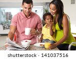 family having breakfast in... | Shutterstock . vector #141037516