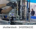 hands of professional plumber... | Shutterstock . vector #1410536132
