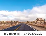 an empty road in a dessert with ... | Shutterstock . vector #1410572222