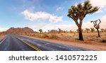 dessert road with joshua trees... | Shutterstock . vector #1410572225