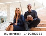 colleagues holding tablet... | Shutterstock . vector #1410583388