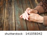 Close Up Of Elderly Male Hands...