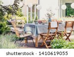 table with wooden chairs in...   Shutterstock . vector #1410619055