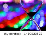 Closeup to hourglass with colorful bokeh background - stock photo