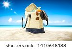 summer bag on sand and beach... | Shutterstock . vector #1410648188