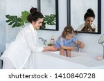 a young woman and a baby wash... | Shutterstock . vector #1410840728