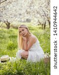 young girl posing in white... | Shutterstock . vector #1410944642