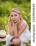 young model blonde woman... | Shutterstock . vector #1410944645