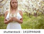 romantic smiling girl in white... | Shutterstock . vector #1410944648