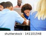 pupils studying at desks in... | Shutterstock . vector #141101548