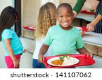 Stock photo elementary pupils collecting healthy lunch in cafeteria 141107062