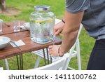 closeup of man pouring lemonade ... | Shutterstock . vector #1411100762