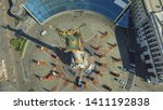 flying drone above the square... | Shutterstock . vector #1411192838