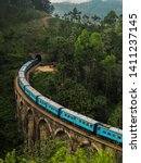 Blue Passenger Train Passing...