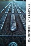 a metallic tactile paving that... | Shutterstock . vector #1411239278