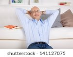 smiling man relaxing and...   Shutterstock . vector #141127075
