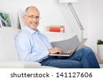 smiling man sitting on the... | Shutterstock . vector #141127606