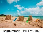 Sand Castle And Toys On...
