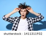 astonished guy in a plaid shirt ...   Shutterstock . vector #1411311932