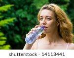 pretty woman drinking water | Shutterstock . vector #14113441