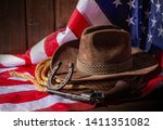 classic cowboy hat lasso and... | Shutterstock . vector #1411351082