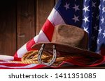 classic cowboy hat lasso and... | Shutterstock . vector #1411351085