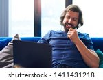 young adult man using laptop in ... | Shutterstock . vector #1411431218