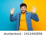 man with curly hair over... | Shutterstock . vector #1411442858